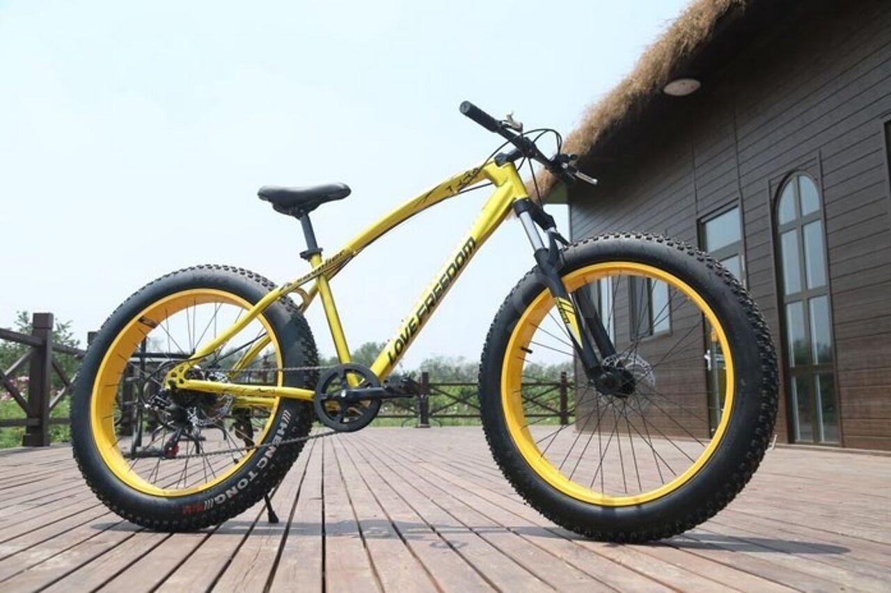 идёт картинки горный велосипед с широкими колесами желто оранжевый цвет светильники стали