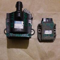 Катушка  c  коммутатором ( модулем ) системы  зажигания  двигателя.