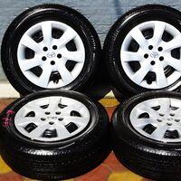 Комплект колёс с колпаками! 195/65R15  Bridgeston Ecopia 2019 год