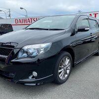 фара левая линзованая (темный хром) для Toyota Fielder NZE144 / ZRE144