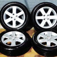 Комплект колёс на титановых дисках 175/65R15 Yokohama BluEarth 2020 г