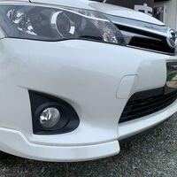клык переднего бампера правый Corolla Axio / Fielder NZE164 / NZE161