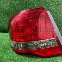 Стоп-сигнал Toyota Corolla Axio NZE144 1NZ задн. лев. (б/у)