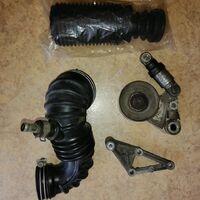 Патрубок воздушного фильтра, ролик приводного ремня, кронштейн ролика